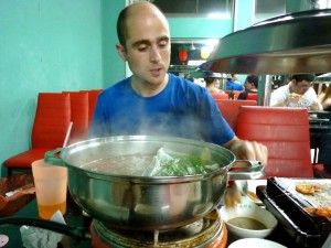Asier sweats through a super spicy steam boat