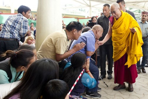 The Dalai Lama greeting attendees on Jun 1, 2013