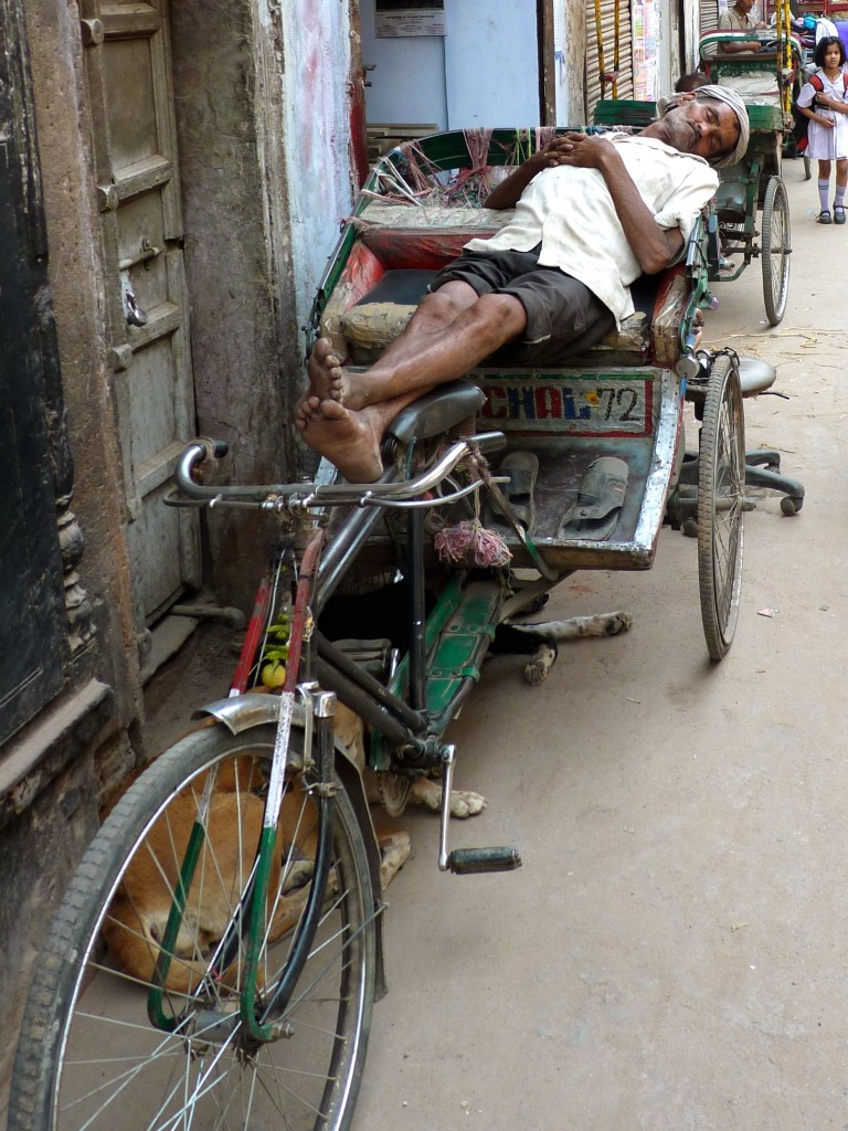 A tri-rickshaw driver takes a nap in Old Delhi